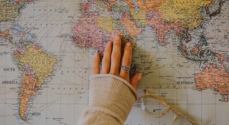 hand on the map